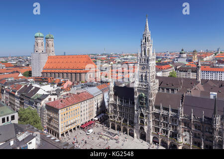 Marienplatz Square with town hall (Neues Rathaus) and Frauenkirche church, Munich, Bavaria, Germany, Europe - Stock Photo