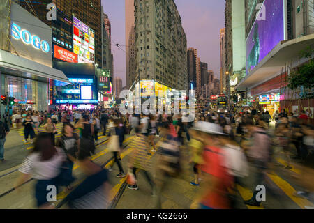 Pedestrians and traffic at a busy road crossing in Causeway Bay, Hong Kong Island, Hong Kong, China, Asia - Stock Photo