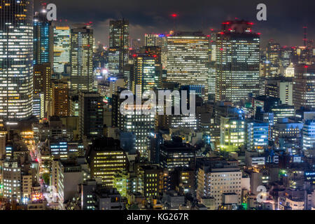 Downtown city buildings at night, Tokyo, Japan, Asia - Stock Photo