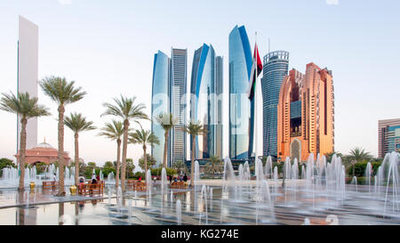 Etihad Towers viewed over the fountains of the Emirates Palace Hotel, Abu Dhabi, United Arab Emirates, Middle East - Stock Photo