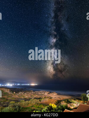 Night sky with Milky Way setting to the sea captured in Crete - Stock Photo
