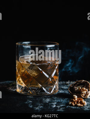 Old fashioned cocktail on dark background - Stock Photo
