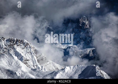 dramatic weather landscape in winter dolomites mountains - Stock Photo