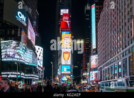 Times Square, New York City. Crowds in Times Square on a fall evening, Midtown Manhattan, NY, USA - Stock Photo