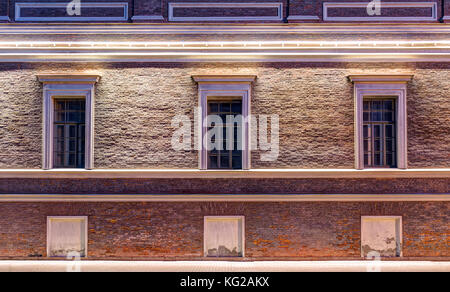 Several windows in a row on night illuminated facade of Central Naval Museum front view, St. Petersburg, Russia - Stock Photo
