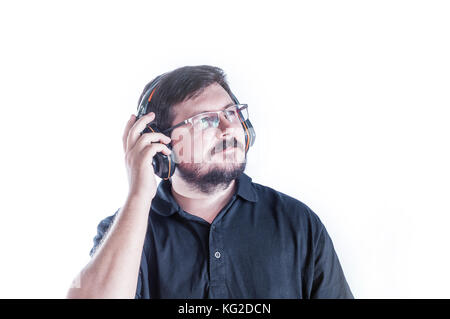 Caucasian man listen music from headphones - Stock Photo