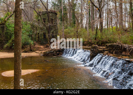 Spillway waterfall and the tower in the Lullwater Park, Atlanta, USA - Stock Photo