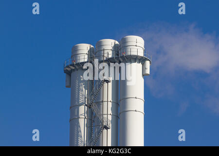 Cooling towers of nuclear power plant against the blue sky - Stock Photo