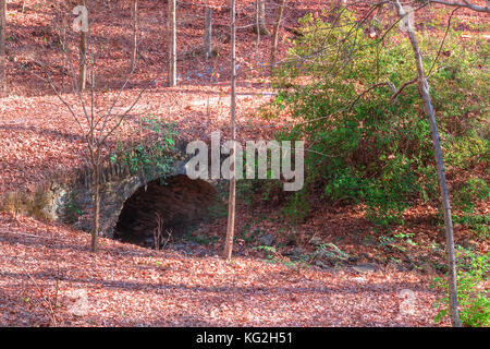 The stone bridge over the Ernest Richardson creek in the Lullwater Park in sunny autumn day, Atlanta, USA - Stock Photo