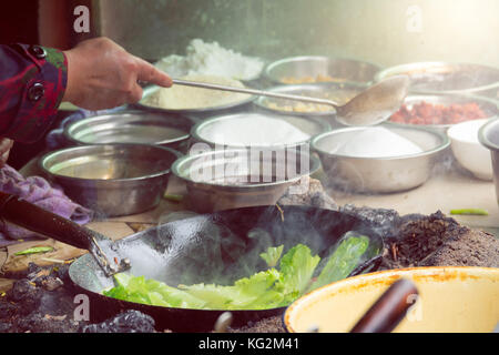 Fried vegetable in a pan , Sichuan street food in chaina - Stock Photo