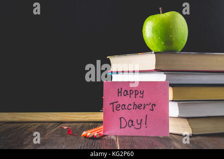 Objects On A Chalkboard Background Books Green Apple