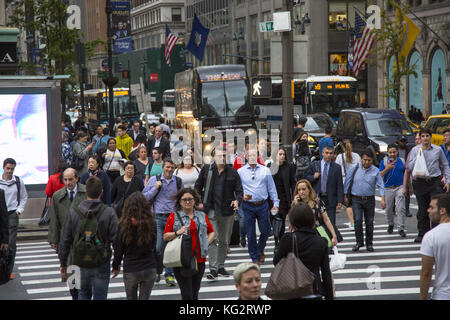 5th Avenue and 42nd Street is one of the busiest street crossings in New York City especially at the evening rush - Stock Photo