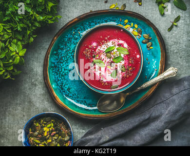 Spring beetroot soup with mint leaves and seeds, top view - Stock Photo