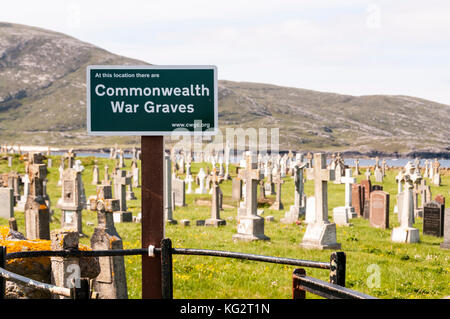 Commonwealth War Graves sign at Borve graveyard on Barra in the Outer Hebrides - Stock Photo