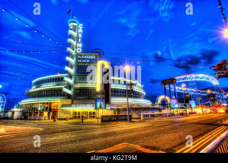 Town of Blackpool, England. Artistic night view of Blackpool Pleasure Beach at the junction of the Promenade and - Stock Photo