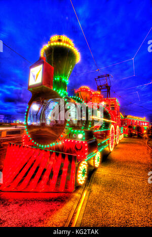 Town of Blackpool, England. Artistic night view of the illuminated trams, during the Blackpool Illumination festivities. - Stock Photo