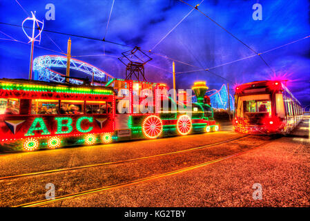 Town of Blackpool, England. Artistic night view of the illuminated trams, during the Blackpool Illumination festivities, - Stock Photo