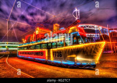 Town of Blackpool, England. Artistic night view of an illuminated tram dressed as a Royal Navy ship, during the - Stock Photo