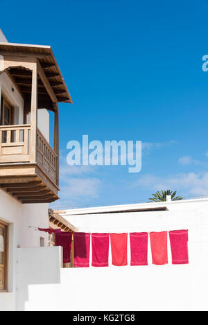 Towels drying on washing line in the town of Haria in Lanzarote, Canary Islands. - Stock Photo