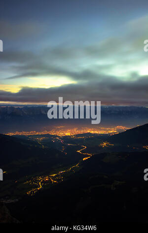 the moment before sunrise in the alps in Stubaital in the Tyrol in Austria - view to Innsbruck - Stock Photo