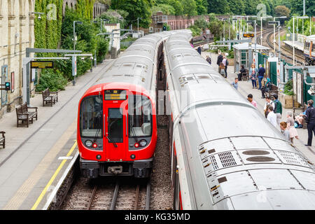 London, UK - October 23, 2017 - West Brompton underground station platforms, with commuters boarding the train - Stock Photo
