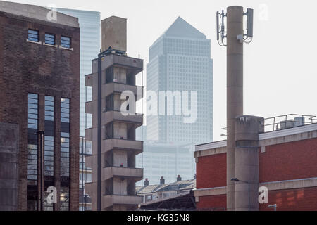 London, UK - October 24, 2017 - Skyscrapers in Canary Wharf seen through old industry buildings in Poplar, East London Stock Photo