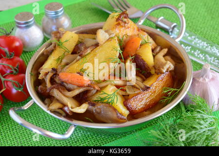 Pan fried potato with oyster mushrooms. Healthy food, vegetarian, vegan - Stock Photo