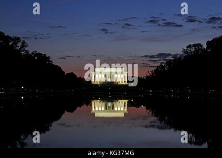 Sunset over the Reflecting Pool and the Lincoln Memorial, Washington DC, United States of America. - Stock Photo