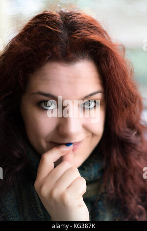 Shy Beautiful lady with Red Hair, Secret Smile - Stock Photo