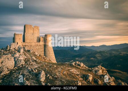 The rolling hills of the Apennines mountain range as seen from Rocca Calascio, featuring Santa Maria della Pietà. - Stock Photo