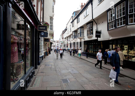 Tourists and shoppers in Stonegate, York City, England - Stock Photo