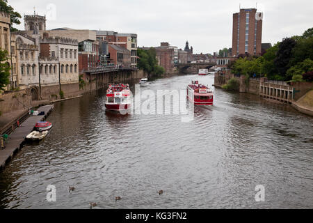 Tourboats on the river Ouse in York City, England - Stock Photo