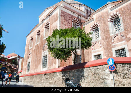 Rhodes, Greece - August 28, 2015: Red wall of a mosque in Rhodes, Greece - Stock Photo