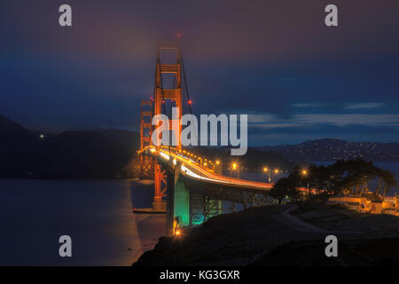 Golden Gate Bridge at night seen from San Francisco. - Stock Photo