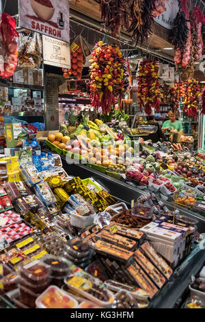 Produce vendor in la Boqueria market, Barcelona, Spain. - Stock Photo