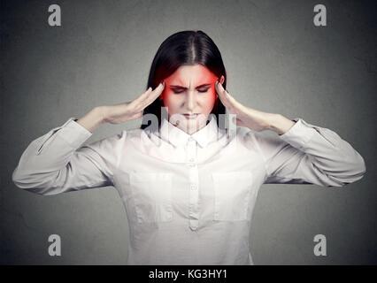 Stressed sad woman with headache - Stock Photo
