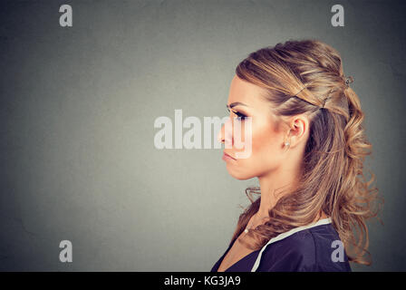 Grumpy annoyed dissatisfied young woman - Stock Photo