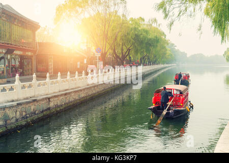 China traditional tourist boats on Beijing canals of Qianhai lake at ShiChaHai district in Beijing, China - Stock Photo