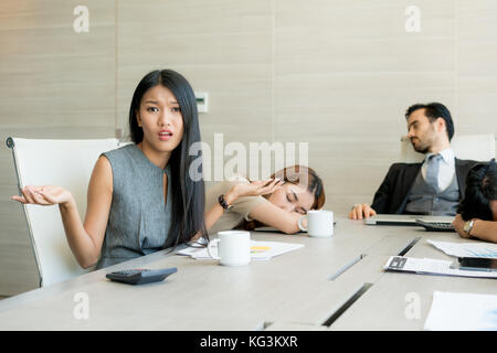 Bored business people and sleeping resting on workplace during work meeting, concept of exhausted businesspeople - Stock Photo