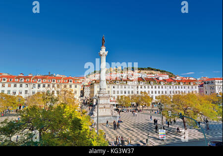View to Rossio Square and castle of Lisbon - Stock Photo