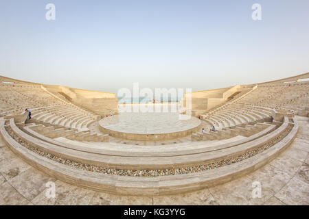 The amphitheater in Katara Cultural Village, Doha Qatar panoramic view in daylight with Arabic gulf in background - Stock Photo
