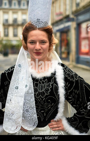 A girl wearing traditional Breton dress in Pont L'Abbe Pays Bigouden Finistere Brittany France - Stock Photo