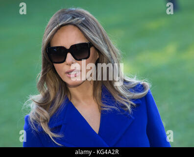 First lady Melania Trump listens as United States President Donald J. Trump speaks to the media before departing - Stock Photo