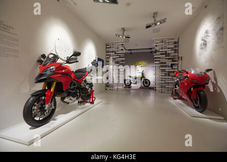 Left to right: Ducati Multistrada, Scrambler street bike, 1098 superbike on display at the Ducati factory museum, - Stock Photo