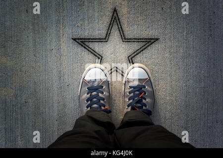 Sneakers on asphalt road with star shape