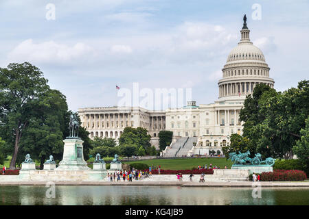Capitol Reflecting Pool, Ulysses S. Grant Memorial, and Capitol in Washington, DC - Stock Photo