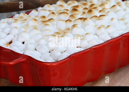 Sweet Potato Casserole baked with mini marshmallows ready for Thanksgiving Day. Extreme shallow depth of field with - Stock Photo