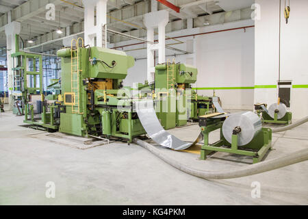 machine for cutting sheet metal in rolls. sheet metal working in rolls - Stock Photo