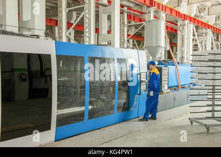 Industrial injection molding press machine for the manufacture of plastic parts using polymers in the management - Stock Photo