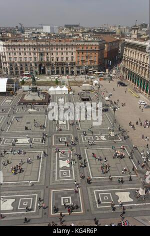 MILAN, ITALY - MAY 9: View from the top of the Duomo Basilica of the square and Milan cityscape - Stock Photo